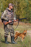 Hunter with gun and dog Royalty Free Stock Image