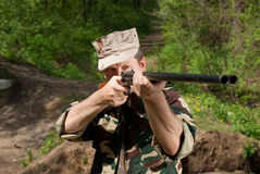 Hunter with gun in hand. Hunting man in the forest royalty free stock image