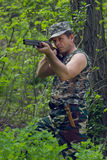 Hunter with gun in hand. Hunting man in the forest stock photos