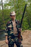 Hunter with gun in hands. Hunter in forest with gun in hands royalty free stock photography