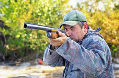 Hunter with a gun. Stock Images