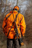 Hunter with gun wearing safety vest Royalty Free Stock Image