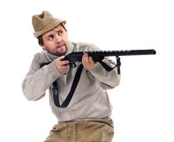 Hunter in hat takes aim from a gun Royalty Free Stock Photo