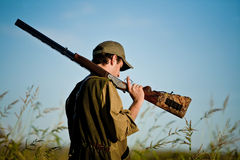 Hunter heading for the hunting spots during hunt Stock Photos