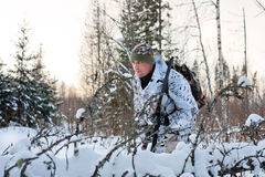 The hunter hides in the winter forest Stock Photography