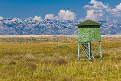 Hunter high stand on Pag island. Field below Velebit mountain, Dalmatia, Croatia Stock Photos