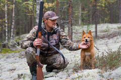 The hunter with his dog Royalty Free Stock Photography
