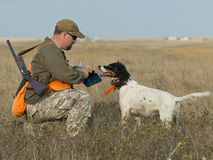 Hunter with his dog. A hunter about to give his dog some water Royalty Free Stock Images