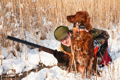 Hunter and his hunting dog looking for a hideout Stock Photography