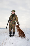 Hunter and his hunting dog in winter open season Stock Image