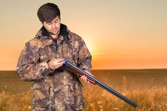 Hunter with his rifle Stock Images