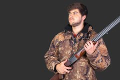 Hunter with his rifle Royalty Free Stock Image