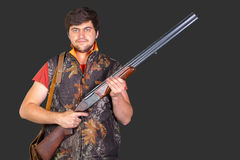 Hunter with his rifle Stock Image