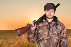 Hunter with his rifle Royalty Free Stock Photos