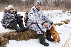 Hunter with his son and dog during the rest Stock Photos