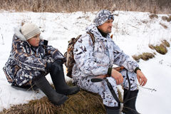 Hunter with his son during the rest Stock Photography