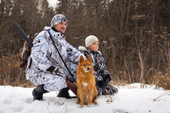 The hunter with his son and their dog Royalty Free Stock Photo