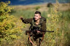 Hunter hold rifle. Man wear camouflage clothes nature background. Hunting permit. Hunting equipment for professionals. Hunting is brutal masculine hobby stock images
