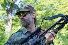 Hunter holding a crossbow Royalty Free Stock Images