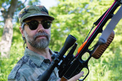 Hunter holding a crossbow Royalty Free Stock Photos