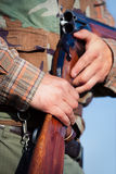 Hunter holding a rifle Royalty Free Stock Image