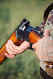 Hunter holding a rifle Royalty Free Stock Photography
