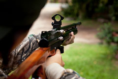 Hunter holding a rifle and waiting for prey Royalty Free Stock Photos