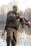 Hunter holds a dead duck Royalty Free Stock Photography