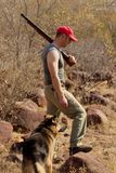 Hunter with rifle and dog Stock Photo
