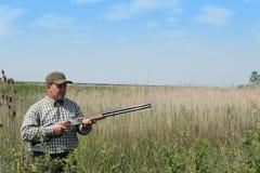 Hunter hunting wild duck Royalty Free Stock Photo