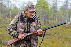 The hunter hunts game Stock Photos