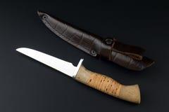 Hunter knife on a black background Stock Image