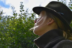 Hunter lady in hat with bird feather. Autumn 2016 stock image