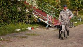Hunter leads dog greyhound