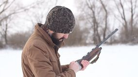 Hunter loading the gun before the hunting outdoors. slow motion. Hunter loading the gun before the hunting outdoors. preparation for killing animals stock video