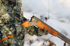 Hunter loading his old russian double-barreled over and under shotgun Stock Image