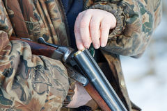 Hunter loading his old russian double-barreled side by side shotgun Stock Images