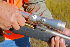 Hunter Loading Rifle. A hunter putting a shell into his rifle Stock Photos