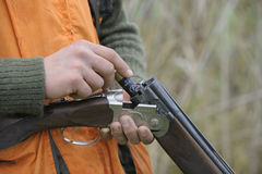 Hunter loading shotgun Royalty Free Stock Images