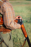 Hunter loading shotgun Stock Photography