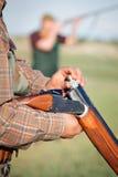 Hunter loading shotgun Royalty Free Stock Photo