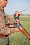 Hunter loading shotgun Royalty Free Stock Photos