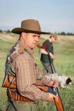 Hunter loading shotgun Royalty Free Stock Image
