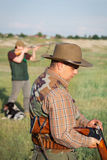 Hunter loading shotgun Stock Photo