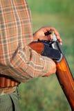 Hunter loading shotgun Stock Image