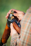 Hunter loading shotgun Royalty Free Stock Photo