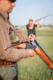Hunter loading shotgun Stock Images