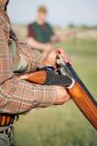 Hunter loading shotgun Royalty Free Stock Photography