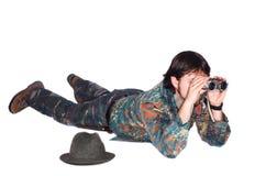 Hunter looking through binoculars Stock Photo