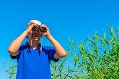 Hunter looking through binoculars Stock Photos